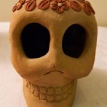 Thoughts on a Flowered Skull from Oaxaca