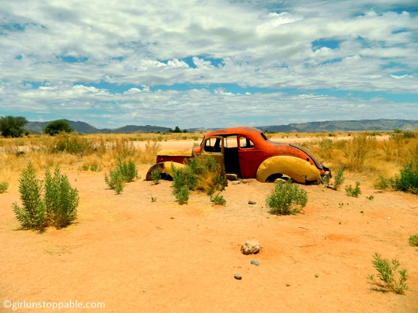 Old car sinking into the sand in Solitaire, Namibia