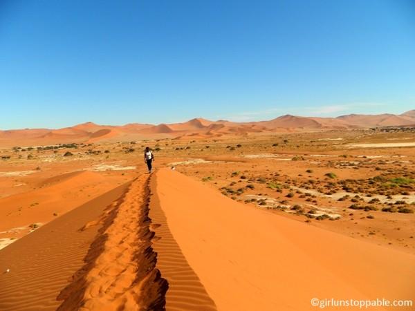 Climbing a sand dune Sossusvlei, Namibia