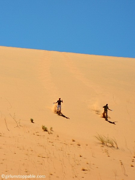 Running down a sand dune in Sossusvlei, Namibia