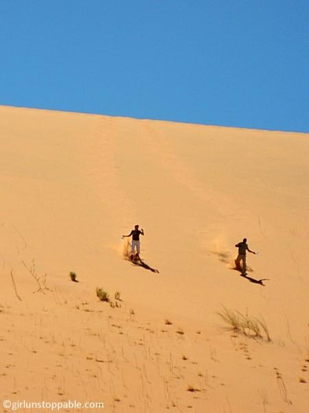 Running down a sand dune in Sossusvlei, Namibia