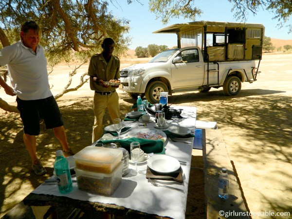 Setting  up champagne brunch in Sossusvlei, Namibia