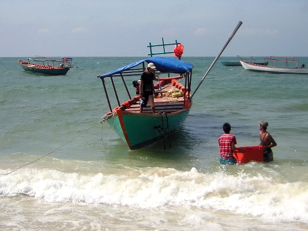 Loading a boat in Sihanoukville, Cambodia
