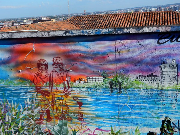 Mural in Cali, Colombia with stencil graffiti