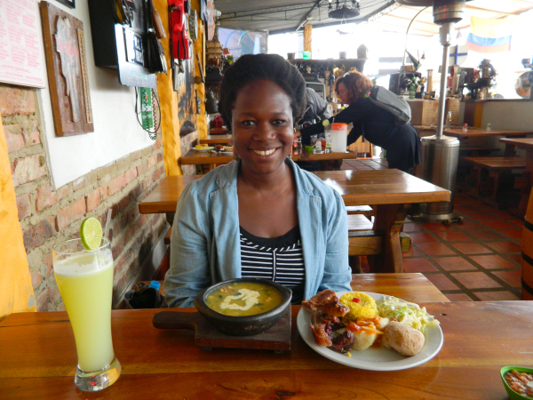 Eating one last large Colombian lunch consisting of ajiaco, meat, potatoes, rice, salad, and lime juicein Zipaquirá, Colombia