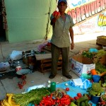 A market vendor poses with one of his peppers at the Tlacolula market in Oaxaca state, Mexico